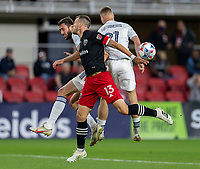 WASHINGTON, DC - MAY 13: Frederic Brillant #13 of D.C. United goes up for a header with Elliot Collier #28 and Fabian Herbers #21 of Chicago Fire FC during a game between Chicago Fire FC and D.C. United at Audi FIeld on May 13, 2021 in Washington, DC.