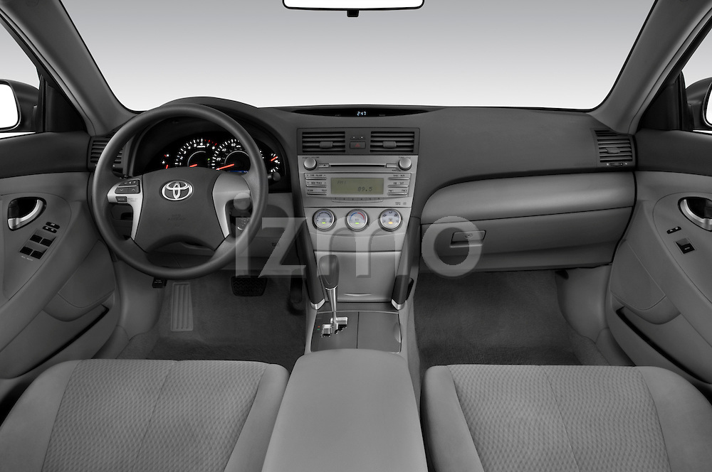 Straight dashboard view of a 2010 Toyota Camry LE.