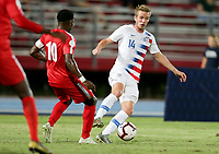 GEORGETOWN, GRAND CAYMAN, CAYMAN ISLANDS - NOVEMBER 19: Jackson Yueill #14 of the United States attempts to move past Arichel Hernandez #10 of Cuba during a game between Cuba and USMNT at Truman Bodden Sports Complex on November 19, 2019 in Georgetown, Grand Cayman.