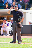 Home plate umpire Kiff Kinkade between innings of the Carolina League game between the Kinston Indians and the Winston-Salem Dash at BB&T Ballpark on April 17, 2011 in Winston-Salem, North Carolina.   Photo by Brian Westerholt / Four Seam Images