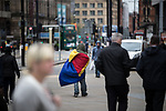 © Joel Goodman - 07973 332324 . 06/04/2017 . Manchester , UK . A man wrapped in a sleeping bag , walks through Piccadilly Gardens . An epidemic of abuse of the drug spice by some of Manchester's homeless population , in plain sight , is causing users to experience psychosis and a zombie-like state and is daily being witnessed in the Piccadilly Gardens area of Manchester , drawing large resource from paramedic services in the city centre . Photo credit : Joel Goodman