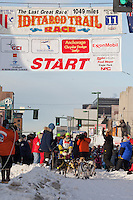 Musher Melissa Owens and Iditarider Kevin Call.leave the 2011 Iditarod ceremonial start line in downtown Anchorage, Alaska
