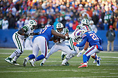 New York Jets running back Trenton Cannon (40) its tackled by Jordan Phillips (97) during an NFL football game against the Buffalo Bills, Sunday, December 9, 2018, in Orchard Park, N.Y.  (Mike Janes Photography)
