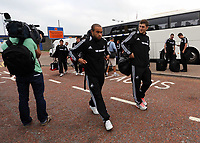Wednesday 28 August 2013<br /> Pictured: Ashley Richards (C) and Ben Davies (R) arriving at Cardiff Airport.<br /> Re: Swansea City FC players and staff en route for their UEFA Europa League, play off round, 2nd leg, against Petrolul Ploiesti in Romania.