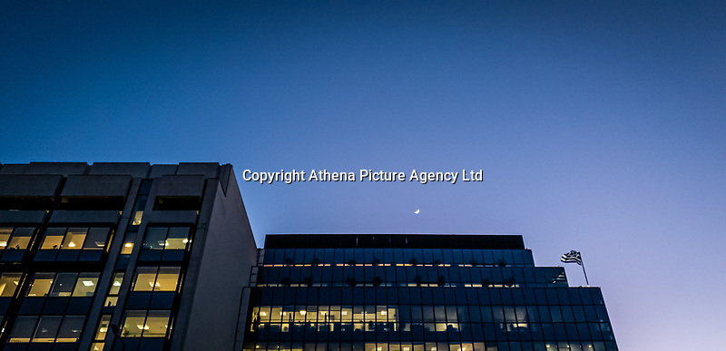 Pictured: The moon is visible over buildings at Panepistimiou Street.<br /> Re: Street photography, Athens, Greece. Thursday 27 February 2020
