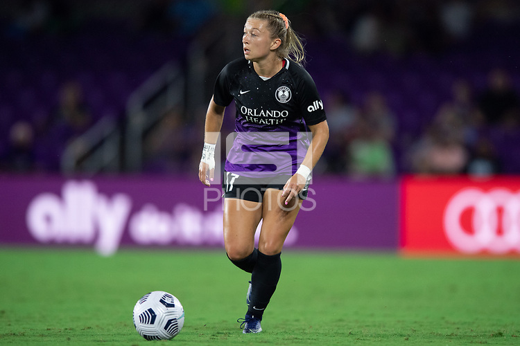 ORLANDO, FL - SEPTEMBER 11: Courtney Petersen #17 of the Orlando Pride dribbles the ball during a game between Racing Louisville FC and Orlando Pride at Exploria Stadium on September 11, 2021 in Orlando, Florida.