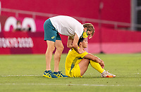 KASHIMA, JAPAN - AUGUST 5: Tony Gustavsson talks with Sam Kerr #2 of Australia after a game between Australia and USWNT at Kashima Soccer Stadium on August 5, 2021 in Kashima, Japan.
