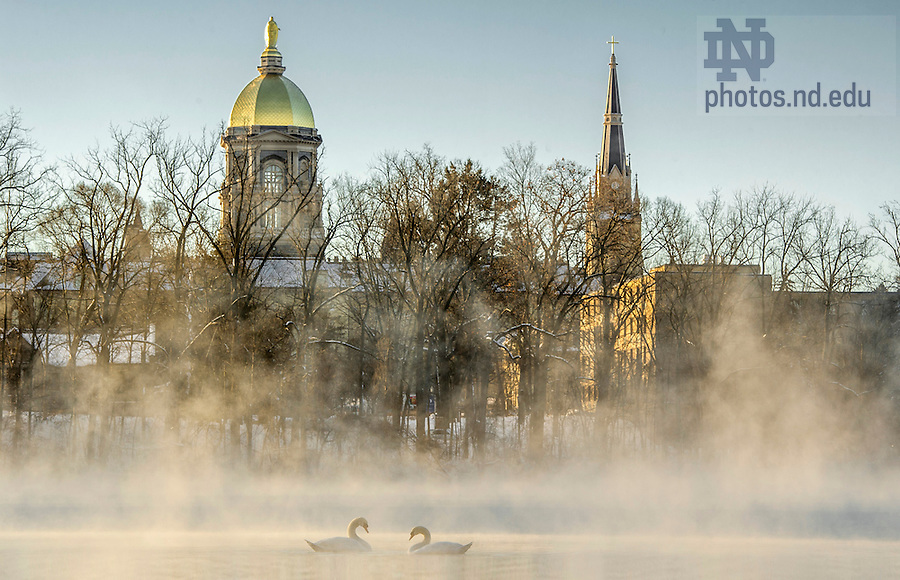 Jan. 13, 2015; Single digit temperatures cause frost to form on the trees and fog to rise on St. Joseph Lake. (Photo by Barbara Johnston/University of Notre Dame)