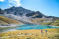 Trail running on the Via Valais, a multi-day trail running tour connecting Verbier with Zermatt, Switzerland. Passing the Lac de Lona.