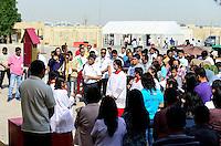 QATAR, Doha, religious complex with churches, filipino migrant worker going to mass on friday / KATAR, Doha, Religionskomplex mit Kirchen am Stadtrand, katholische Kirche, philippinische Gastarbeiter in Tagalog Messe am Freitag, Kreuzgang, Hintergrund Zelt fuer security check der qatari police