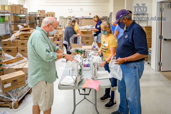 September 24, 2021; Volunteers fill bags of food at the Alumni Association service event at Our Lady of the Angels Church, part of the 2021 Shamrock Series in Chicago. (Photo by Matt Cashore/University of Notre Dame)