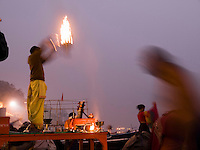 A Hindu priest performs a ritual at dawn on the bank of the holy river Ganges, an important pilgrimge site for Hindu's, in Varanasi, Uttar Pradesh, India