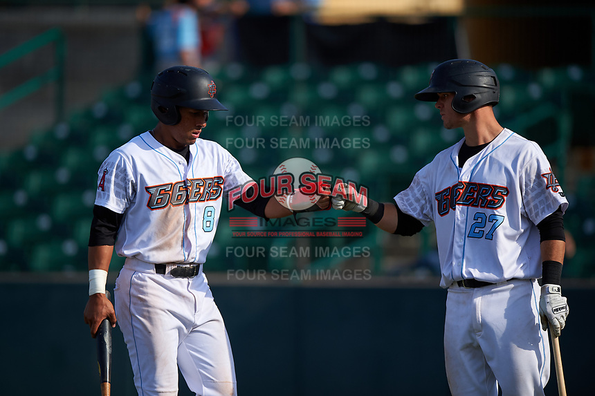 Inland Empire 66ers second baseman Jahmai Jones (8) is congratulated by Jack Kruger (27) after scoring a run during a California League game against the Lancaster JetHawks at San Manuel Stadium on May 20, 2018 in San Bernardino, California. Inland Empire defeated Lancaster 12-2. (Zachary Lucy/Four Seam Images)
