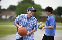 Aaron Anderson of Springdale(from left) and A.P. Anderson, 13, play bankshot basketball, Sunday, August 1, 2021 at the bank shot basketball court at Ward Nail Park in Lowell. Check out nwaonline.com/210802Daily/ for today's photo gallery. <br /> (NWA Democrat-Gazette/Charlie Kaijo)