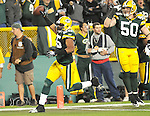 Green Bay Packers linebacker Desmond Bishop, left, scores a touchdown after intercepting a Brett Favre pass against the Minnesota Vikings during the 3rd quarter of the game at Lambeau Field in Green Bay, Wis., on Oct. 24, 2010.