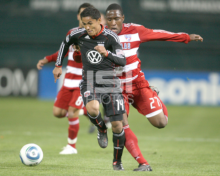 Andy Najar #14 of D.C. United tries to avoid a tackle from Edson Edwards #27 of F.C. Dallas during a US Open Cup match on April 28 2010, at RFK Stadium in Washington D.C. United won 4-2.