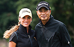HAIKOU, CHINA - OCTOBER 29:  Hong Kong actor Simon Yam (R) and Spanish golfer Belen Mozo pose on the 12nd green during day three of the Mission Hills Start Trophy tournament at Mission Hills Resort on October 29, 2010 in Haikou, China. The Mission Hills Star Trophy is Asia's leading leisure liflestyle event which features Hollywood celebrities and international golf stars.  Photo by Victor Fraile / The Power of Sport Images