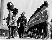 La visite du Roi George VI au Canada en 1939.<br /> <br /> <br /> <br /> <br /> <br /> La visite du Roi George VI au Canada en 1939.<br /> <br /> <br /> <br /> <br /> <br /> as well as civil welcome was accorded his majesty by Montreal. When the royal train Park Avenue station; selected companies of the Black Watch; the Royal Regiment; and the Fusiliers were lined up as a special guard of honor. After leaving the trian the King reviewed his guard of honor. he is shown pacing before the lines of the Fusiliers; who stand at attention with rifle butts eanwhile the great guns of Montreal boomed their royal salute; 21 guns in all. Within seven inspection of the guard of honor was over.<br /> <br /> [unknown]<br /> Picture, 1939, English<br /> <br /> PHOTO : Toronto Star Archives - AQP