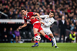 "Carlos Henrique Casemiro (r) of Real Madrid battles for the ball with Paulo Henrique Chagas de Lima ""Ganso"" of Sevilla FC during their Copa del Rey Round of 16 match between Real Madrid and Sevilla FC at the Santiago Bernabeu Stadium on 04 January 2017 in Madrid, Spain. Photo by Diego Gonzalez Souto / Power Sport Images"