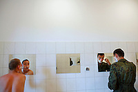 Young soldiers shave in their barracks. This year's class of drafted recruits is the final one after 90 years of compulsory military service, as Poland's army turns professional in 2009.