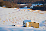 Double wide mobile home next to harvested cornfield hillside in snow. Echard Road, Lycoming County, PA