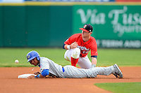 Brevard County Manatees second baseman Greg Hopkins #14 can not come up with the throw as a runner slides in during a game against the Daytona Cubs at Spacecoast Stadium on April 5, 2013 in Viera, Florida.  Daytona defeated Brevard County 8-0.  (Mike Janes/Four Seam Images)