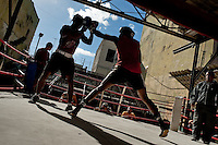 Cuban fighters during a training session at Rafael Trejo boxing gym in Havana, Cuba, 5 February 2010. During the last 30 years Cuba has produced more World Champions and Olympic gold medallists in amateur boxing than any other country. Many famous fighters, who came out of Cuba, were training at Rafael Trejo boxing gym in their youth. This run down open air facility in the Old Havana is a place of learning and mastering the art of boxing by the old school style. Boys begin their training very young. As sports are given a high political priority in Cuba, all children are systematically encouraged to develop their skills. Those who succeed will become heroes of Cuban society.