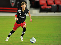 WASHINGTON, DC - SEPTEMBER 27: Griffin Yow #22 of D.C. United moves the ball during a game between New England Revolution and D.C. United at Audi Field on September 27, 2020 in Washington, DC.