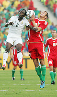 Hungary's Andras Simon (8) battles Ghana's Emanuel Agyemang-Badu (8) during the FIFA Under 20 World Cup Semi-final match at the Cairo International Stadium in Cairo, Egypt, on October 13, 2009. Costa Rica won the match 1-2 in overtime play. Ghana won the match 3-2.