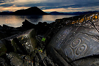 close-up of rock carvings found on Petroglyph Beach State Historic Site