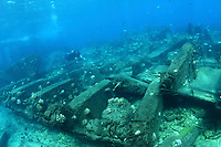 shipwreck, Water barge, and diver, Channel at Midway atoll, Papahanaumokuakea Marine National Monument, Northwestern Hawaiian Islands, Hawaii, USA, Pacific Ocean