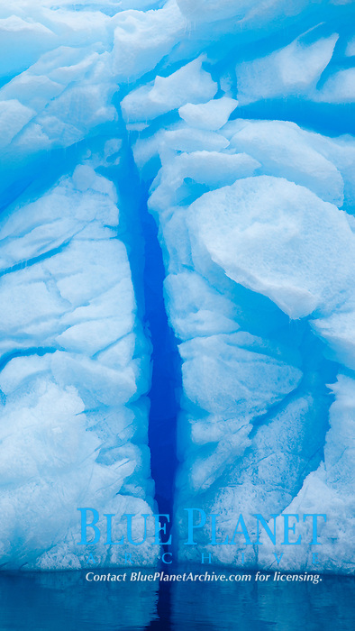 Iceberg detail.  Cracks and melt patterns.  Blue ice.