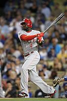 Brandon Phillips #4 of the Cincinnati Reds bats against the Los Angeles Dodgers at Dodger Stadium on July 3, 2012 in Los Angeles, California. Los Angeles defeated Cincinnati 3-1. (Larry Goren/Four Seam Images)