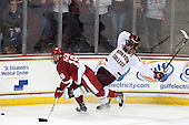 Jake McCabe (Wisconsin - 19), Patrick Brown (BC - 23) - The Boston College Eagles defeated the visiting University of Wisconsin Badgers 9-2 on Friday, October 18, 2013, at Kelley Rink in Conte Forum in Chestnut Hill, Massachusetts.