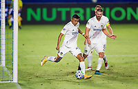 CARSON, CA - OCTOBER 18: Julian Araujo #22 of the Los Angeles Galaxy passes off the ball during a game between Vancouver Whitecaps and Los Angeles Galaxy at Dignity Heath Sports Park on October 18, 2020 in Carson, California.