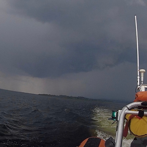 The inshore RNLI lifeboat Jean Spicer on Lough Derg as a thunderstorm looms overhead on Friday 23 July