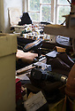"""01/05/16<br /> <br /> A cycling shoe on a traditional cobbler's 'last"""". A """"last"""" is the term for the foot-like model used to mould the shoe shape.<br /> <br /> <br /> Fuelled by a growing trend for vintage cycling, England's last remaining heavy duty boot-maker, tucked away in the heart of the Derbyshire Peak District, is pedalling a new style of footwear.<br /> <br /> Full story here: http://www.fstoppress.com/articles/vintage-cycle-shoes/<br /> <br />  .For hipster retro-cycling enthusiasts after the authentic vintage look, it's the only English manufacturer of leather shoes designed to work with old-fashioned bike pedal clips.<br /> <br /> For well over a century the family-run firm William Lennon and Co has been hand-making safety boots for the surrounding quarry and lead mining industries.<br /> <br /> And now it is applying the same high level of traditional skill and quality to old-style cycle shoes.<br /> <br /> Located in the small village of Stoney Middleton, the company produces more than 500 pairs of work boots a week and started to make the toe-clip cycle shoes around seven years ago, when the only other manufacturer in Leeds shut down.<br /> <br /> <br /> All Rights Reserved: F Stop Press Ltd. +44(0)1335 418365   www.fstoppress.com."""
