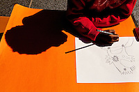 A child draws her version of the iconic Firebird statue during the Wells Fargo Community Celebration, held October 29, 2011 in downtown Charlotte NC. The daylong festival took place in the streets, in public atriums and in downtown museums, which offered free admission all day long. Wells Fargo, which this month completed its conversion from Wachovia, picked up the bill.