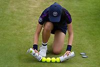 3rd July 2021; Wimbledon, SW London. England; Wimbledon Tennis Championships, day 6;  A ballboy breaks open a new set of game balls