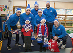 St Johnstone players took some festive cheer to Fairview School in Perth gving out selection boxes and gifts to the pupils…Pictured from left, Keith Watson, Joe Shaughnessy, Zander Clark, Paul Paton, Alan Mannus and David Wotherspoon with primary pupils Jack (left) and Logan<br />