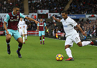 Wayne Routledge of Swansea City FC looks to cross the ball into the box past Winston Reid of West Ham United during the Premier League match between Swansea City and West Ham United at The Liberty Stadium, Swansea, Wales, UK. Monday 26 December 2016