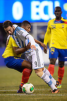 Argentina forward Gonzalo Higuain (9) battles for the ball with Ecuador midfielder Jorge Guagua (2) during the second half . Argentina and Ecuador played to a 0-0 tie during an international friendly at MetLife Stadium in East Rutherford, NJ, on November 15, 2013.