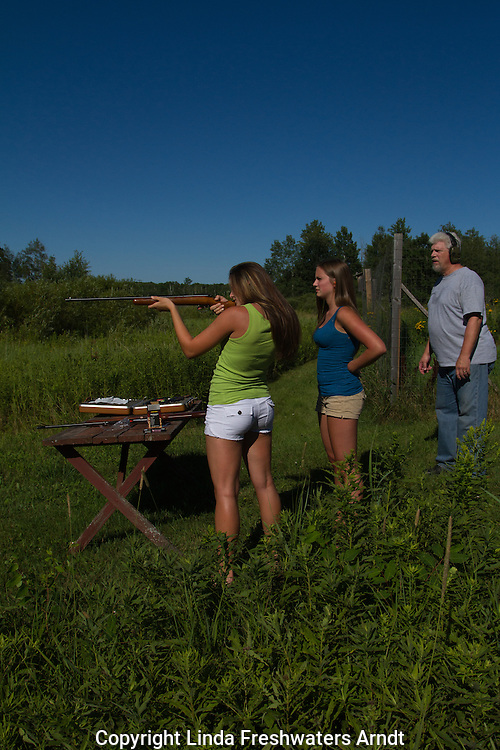 Young woman learning how to shoot