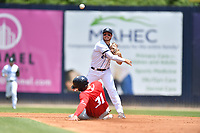 Asheville Tourists second baseman Kyle Datres (3) turns a double play as Abrahan Gutierrez (3) of the Lakewood BlueClaws slides into second base at McCormick Field on June 16, 2019 in Asheville, North Carolina. The BlueClaws defeated the Tourists 6-5. (Tony Farlow/Four Seam Images)