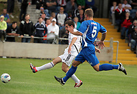 Pictured L-R: Angel Rangel of Swansea scoring, he is marked by Kye Edwards of Port Talbot. Saturday 17 July 2011<br />