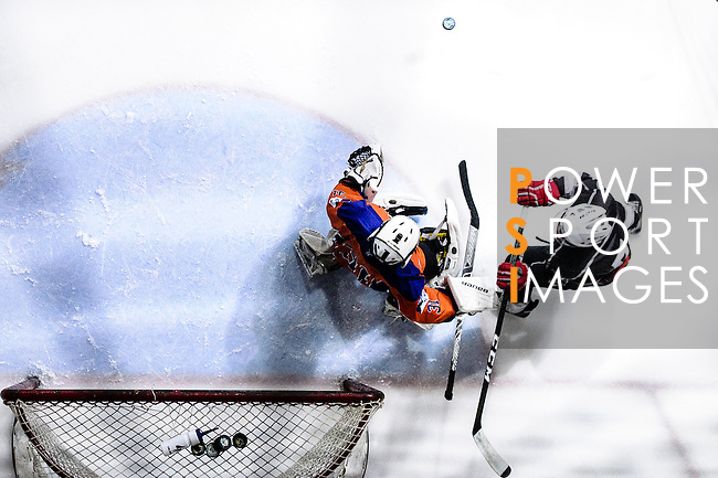 Gaggia Empire Skater #7 Terence Chim (r) battle in the goal mouth with Principal Team Goalie #31 Matthew Young (l) during the Principal Standard League match between Principal vs Gaggia Empire at the Mega Ice on 24 January 2017 in Hong Kong, China. Photo by Marcio Rodrigo Machado / Power Sport Images