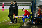Ben Rhodes of Stocksbridge with ice on his inured ankle. Stocksbridge Park Steels v Pickering Town, Evo-Stik East Division, 17th November 2018. Stocksbridge Park Steels were born from the works team of the local British Steel plant that dominates the town north of Sheffield.<br /> Having missed out on promotion via the play offs in the previous season, Stocksbridge were hovering above the relegation zone in Northern Premier League Division One East, as they lost 0-2 to Pickering Town. Stocksbridge finished the season in 13th place.