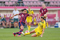KASHIMA, JAPAN - AUGUST 5: Carli Lloyd #10 of the United States is defended by Emily van Egmond #10 of Australia during a game between Australia and USWNT at Kashima Soccer Stadium on August 5, 2021 in Kashima, Japan.