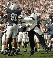State College, PA - 10/15/2011:  Penn State defensive coach Larry Johnson celebrates a successful play with DE Jack Crawford.  Penn State defeated Purdue by a score of 23-18 on October 15, 2011, homecoming, at Beaver Stadium...Photo:  Joe Rokita / JoeRokita.com..Photo ©2011 Joe Rokita Photography