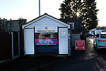 Congleton Town 1 Coventry United 1 (Pens 4-3), 19/12/2020. Ivy Gardens, FA Vase Third Round. A club official puts out a Covid-19 warning sign at the entrance to the ground before Congleton Town play Coventry United. The home team were founded in 1901 and played in the North West Counties League Premier Division. They defeated their opponents from the Midland League Premier Division 4-3 on penalties after the match ended 1-1, watched by 300 spectators, the maximum permitted under Covid-19 restrictions. Photo by Colin McPherson.